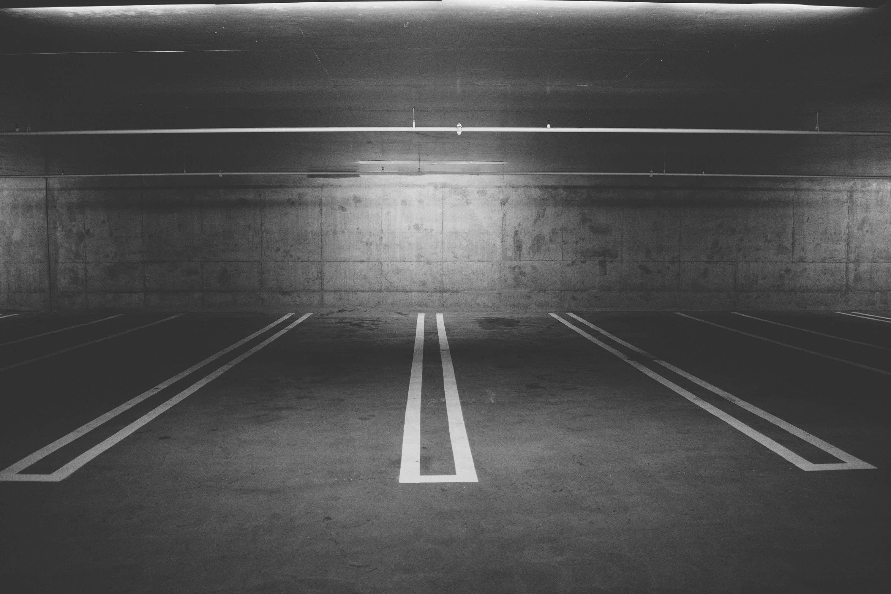 parking-spaces-white-lines-dividing-wall-at-back