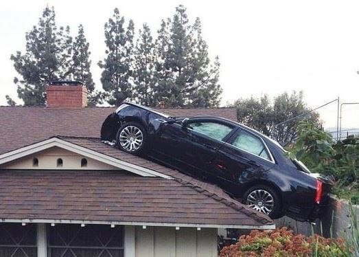 car-ontop-of-house-roof